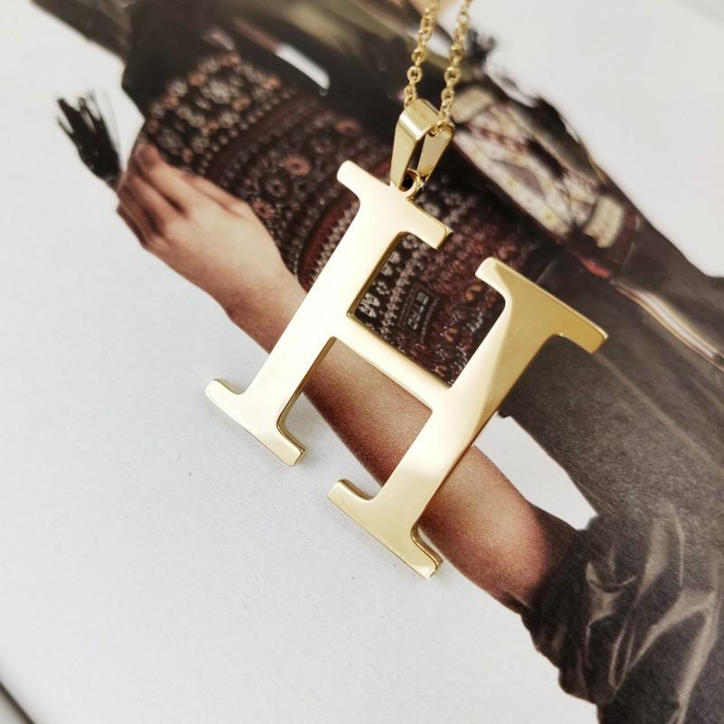 Naszyjnik stal chirurgiczna literka platerowana złotem NST100H