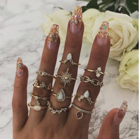 Zestaw 12 pierścionków złote crystal PE51